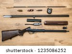 disassembled shotgun parts and... | Shutterstock . vector #1235086252