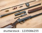 disassembled shotgun parts and... | Shutterstock . vector #1235086255