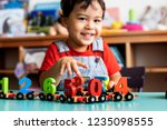 little boy playing mathematics... | Shutterstock . vector #1235098555