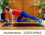 woman doing mountain climbers...   Shutterstock . vector #1235114962