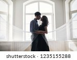 guy and girl by the window | Shutterstock . vector #1235155288