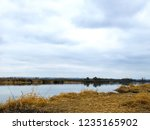 fishing rods in the fall by the ...   Shutterstock . vector #1235165902