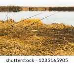 fishing rods in the fall by the ...   Shutterstock . vector #1235165905