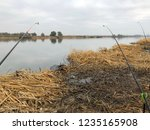fishing rods in the fall by the ...   Shutterstock . vector #1235165908