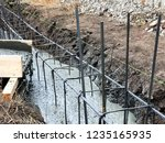 builders pour concrete into the ...   Shutterstock . vector #1235165935