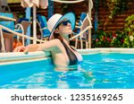 pretty girl with black... | Shutterstock . vector #1235169265
