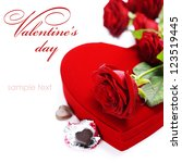 Stock photo red roses and chocolate hearts for valentine s day with sample text 123519445