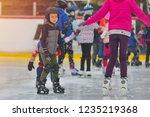 adorable little boy in winter... | Shutterstock . vector #1235219368