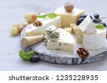 cheese board soft cheese  nuts... | Shutterstock . vector #1235228935