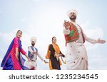 sikh people dancing  | Shutterstock . vector #1235234545