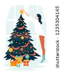 a woman decorates a christmas... | Shutterstock .eps vector #1235304145