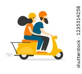 Man And Woman Riding A Moped....