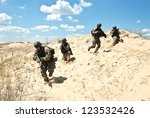 Soldiers Running Through The...