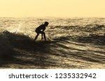 silhouette of man walking on... | Shutterstock . vector #1235332942