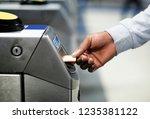 man inserting a subway pass | Shutterstock . vector #1235381122
