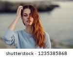cute red haired woman on the...   Shutterstock . vector #1235385868