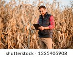 handsome farmer smiling and... | Shutterstock . vector #1235405908