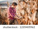 portrait of handsome farmer... | Shutterstock . vector #1235405962