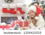 happy little girl in santa hat...   Shutterstock . vector #1235422525