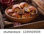 homemade cinnamon buns with...   Shutterstock . vector #1235424535