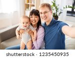 mixed race family  parenthood... | Shutterstock . vector #1235450935