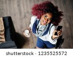 attractive african american... | Shutterstock . vector #1235525572