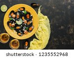 black pasta spaghetti with... | Shutterstock . vector #1235552968