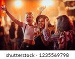 female friends drinking beer... | Shutterstock . vector #1235569798