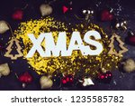 xmas text decoration on a black ... | Shutterstock . vector #1235585782