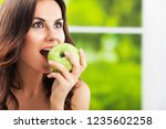 young beautiful woman eating... | Shutterstock . vector #1235602258