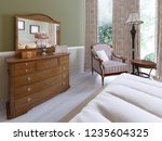 wooden dresser with mirror and... | Shutterstock . vector #1235604325