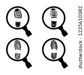 imprint of a shoe sole under a...   Shutterstock .eps vector #1235610382