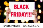 black friday  female hands... | Shutterstock . vector #1235635672