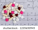pills and tablets lying on... | Shutterstock . vector #1235650945