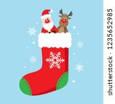 christmas sock in red color... | Shutterstock .eps vector #1235652985