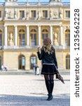 woman at versailles palace.... | Shutterstock . vector #1235662228