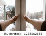 the man opens the window. wide... | Shutterstock . vector #1235662858