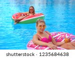 girl smimming in pool on the... | Shutterstock . vector #1235684638