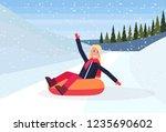 happy woman sledding on snow... | Shutterstock .eps vector #1235690602
