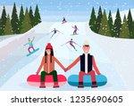 couple sledding on snow rubber... | Shutterstock .eps vector #1235690605