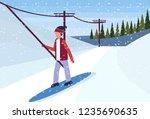 man snowboarder using ski lift... | Shutterstock .eps vector #1235690635