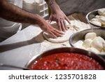 preparing pizza dought on a... | Shutterstock . vector #1235701828