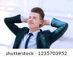 closeup.meditating businessman... | Shutterstock . vector #1235703952