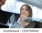 bottom view.colleagues looking... | Shutterstock . vector #1235704042