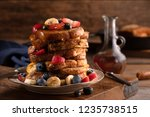 tall stack of french toast... | Shutterstock . vector #1235738515