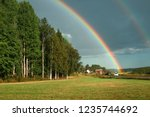 rainbow over the forest after... | Shutterstock . vector #1235744692