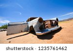wrecked cars lie abandoned in... | Shutterstock . vector #1235761462