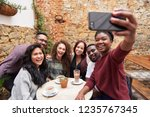 diverse group of smiling young... | Shutterstock . vector #1235767345