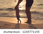 silhouette of father and little ... | Shutterstock . vector #1235771155