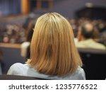 unrecognisable woman attending... | Shutterstock . vector #1235776522